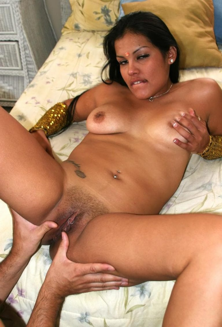 Golden girl from India shows her pierced pussy