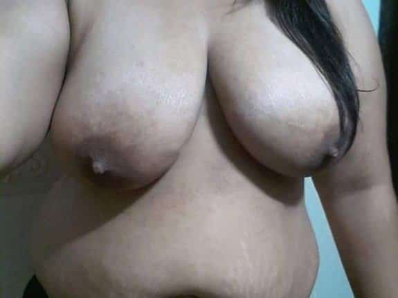 Chubby cute girl showing her bare boobs