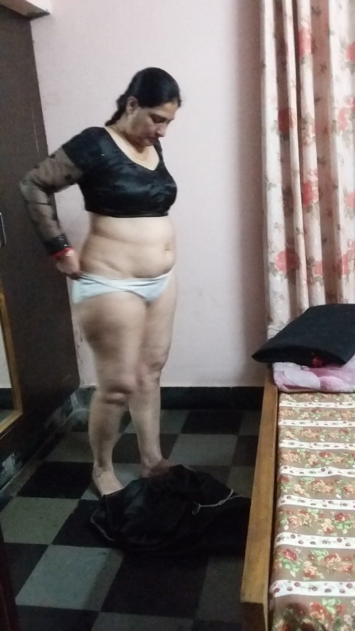 Rich Indian housewife taking off her panty